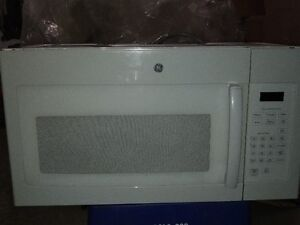 2 Cu Ft GE White OTR microwave less tha 2 years old.