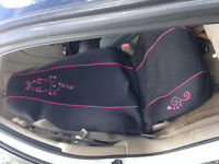 2 seat covers and a steering wheel cover