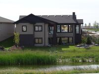 Spectacular Gino's Showhome walk-out bung. In Bridgewater Trails