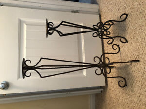 Strong wrought iron stands. Well made. Good quality. $25.00 obo