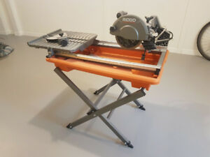 "Rigid 7"" Wet Table Saw with stand and rolling table"