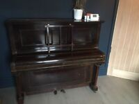 Free Piano. Must go Sunday or Monday