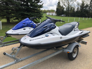 Pair of 2003 kawasaki jet ski's w/trailer. Only 76 hrs & 123 hrs