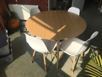 Round dining table & Eiffel dining chairs Ikea / Habitat style