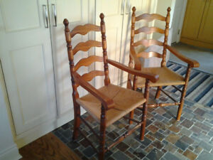 Pair of ladder-back wooden armchairs with rush seats.