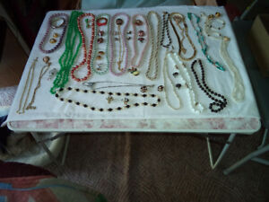 Huge assortmenNecklaces, watches, broaches, ear rings, bracelets