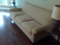 Oatmeal-Coloured Three-Seater Couch - $300