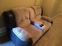 Dual reclining love seat with storage compartment