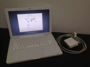 2009 White Macbook, El capitan with Charger