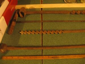 antique hole auger tool. 4 off.