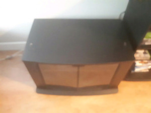 Need gone wooden cabinet TV stand