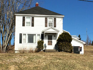 well maintained older home with garages