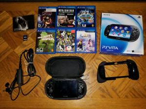 PS Vita - OLED, 8 games + accessories