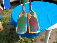 Large paddle and small ones all made out of cedar wood