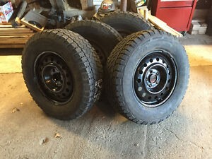 4 studded winter tires and 16 inch rims
