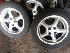 roue originale mazda protege  2000 avec pneu