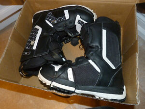 pair of salmon snow boarding boots size 7.