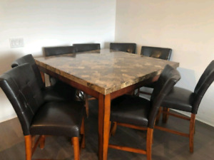 pub style marble top dining table and 8 pub chairs