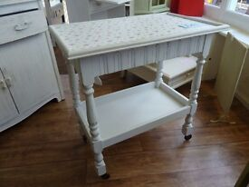 Small white table with hidden compartment