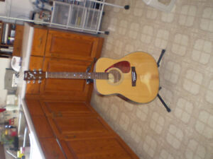 guitar for sale and cd holder