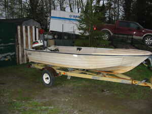 14 Foot Smoothwater fiberglass fishing boat with 25hp Johnson o