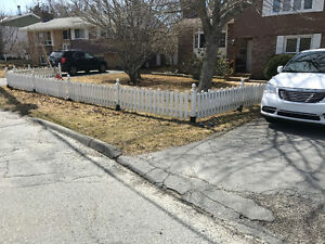 Decorative white picket fence with anchors