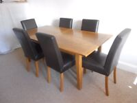 Solid wood dining table and real leather chairs