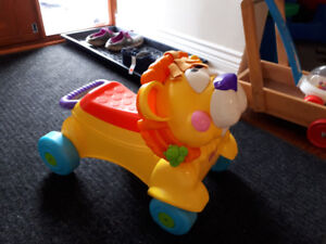 Fisher price walker and  ride-on lion.