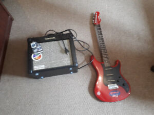 Yamaha SE203 electric guitar and amplifier for sale.