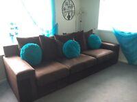 Brown corner sofa and swivel chair