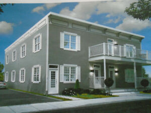 950.$NEUF,STYLE CONDO.2 CAC,occupation rapide.poss.garage.