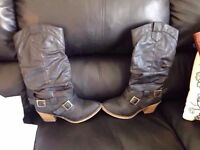 Woman's black and light brown leather boots