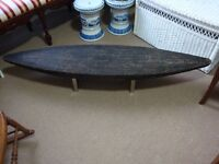 Ebonized Rush Covered Surfboard Shaped Coffee Table / Ottoman