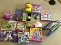 Four bags of toddler girl toys, board games etc