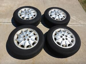 4 BRIDGESTONES IN GREAT CONDITION AND RIMS.