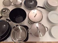 Kitchen kit with pots, pans, plates, glasses, cups, cutlery