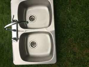 Stainless steel double sink including faucet