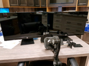 """2 - 27"""" monitors with floating monitor stand."""