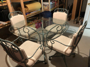 Glass table with 4 matching chairs