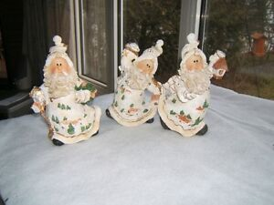 THREE PORCELAIN SANTAS