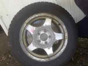 Snow tires on rims  225/60/R16
