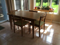 Teak dining table and four chairs.