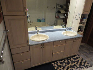 Double sink vanity with right and left side standing cabinets