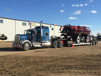 need equipment hauled? we can help! we also haul hay!