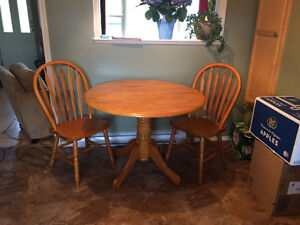 Beautiful solid oak table and two chair set!