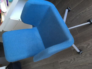 Blue cushioned chair with wheels