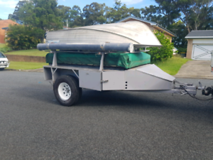 Camper trailer with boat and 2010 Yammaha outboard