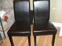 Pair of faux leather chairs