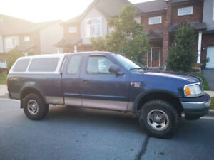 2003 Ford F150 4X4 w/ bed covers