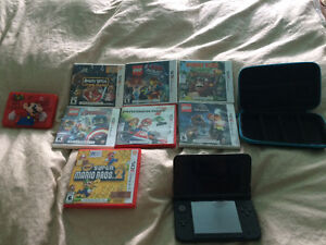 Nintendo 3DS XL with case and games case and charger